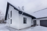 Residential house on winter cloudy day. White house in snow - 241629916
