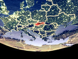 Satellite view of Slovakia from space at night. Beautifully detailed plastic planet surface with visible city lights.