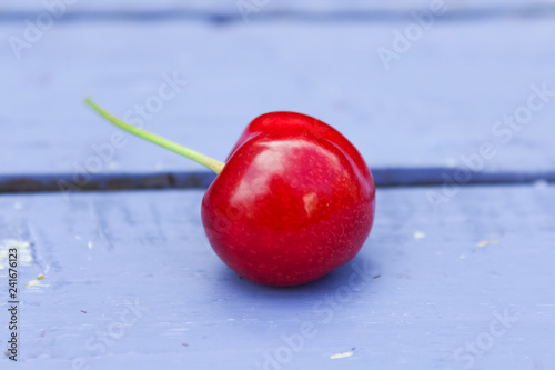 natural organic cherry on wooden background