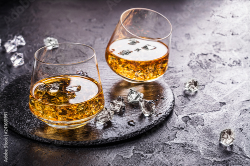Leinwanddruck Bild Two glasses of Cognac with ice cubes