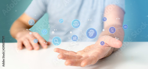 Businessman holding Cloud of justice and law icon bubble with data 3d rendering © Production Perig