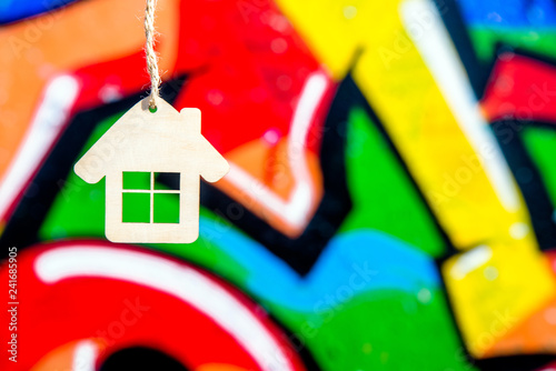 House symbol on a background of colorful graffiti