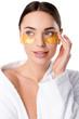 Leinwanddruck Bild - beautiful woman in white bathrobe with golden eye patches isolated on white