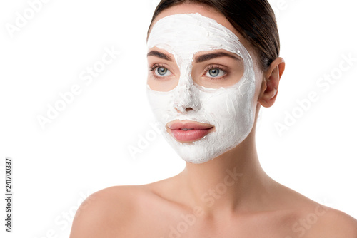 Leinwanddruck Bild beautiful woman with facial skin care mask isolated on white