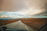 Driving a car on a mountain road. Nature of north Norway. Polar circle. The road to Nordkapp