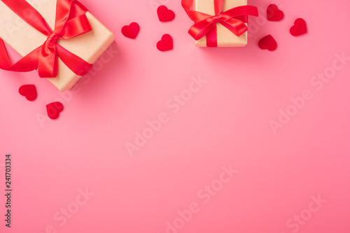 Kraft Gift box with beautful red ribbon and rose, concept of Valentine's, anniversary, mother's day and birthday greeting, copy space, top view. - 241703334