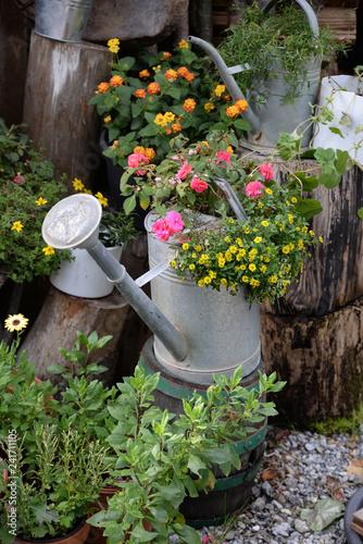 Foto Murales Gießkanne mit Blumen