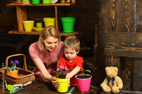 mata magnetyczna Summer concept. Mother and child plant flower in summer. Mother and son potting summer plant. Summer fun just began
