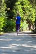Leinwanddruck Bild - young female runner training for marathon