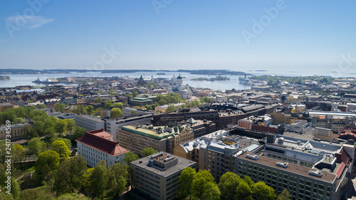 Aerial view of capital city of Finland. Beautiful blue sky in the sunny spring day. - 241734569