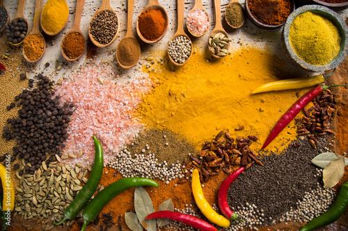 Leinwandbild Motiv Hot spices in wooden bowls