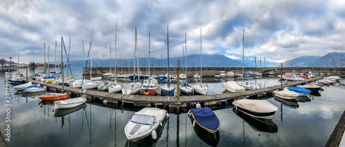 Panoramic view of New Harbor of Luino on the Lake Maggiore in cloudy day, province of Varese, Italy