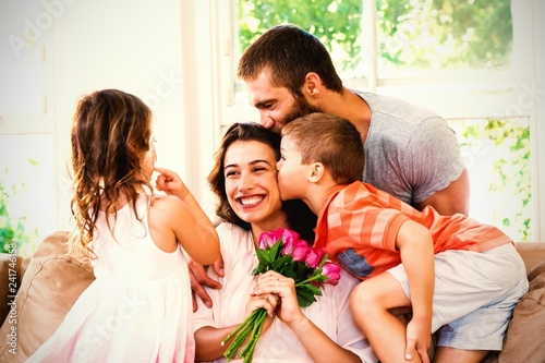 Mother receiving bunch of flowers from her family