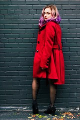 Portrait of a young woman in a red coat