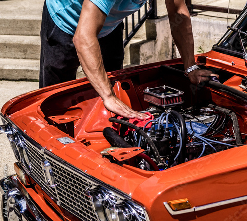 Leinwandbild Motiv man repairing a classic car