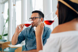 Couple romantic date drink glass of red wine at restaurant. - Image - 241772104