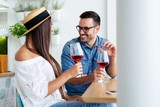 Happy couple romantic date drink glass of red wine at restaurant. - Image - 241773110