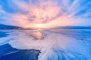Frozen surface of Baikal lake at sunset.