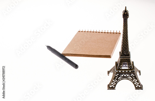 notebook and pen with Eiffel Tower