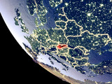 Orbit view of Slovakia at night with bright city lights. Very detailed plastic planet surface.