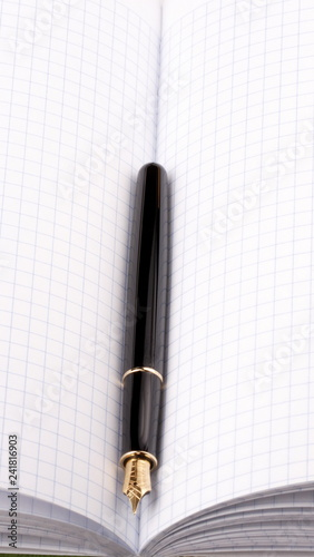 fountain pen on paper notebook