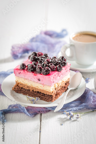 Delicious cake with black currant on white table - 241831728