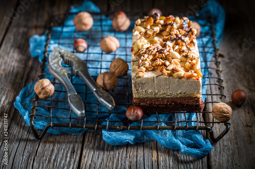 obraz lub plakat Closeup of delicious chocolate cake with walnuts and moouse