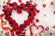 Leinwanddruck Bild - Red roses in shape of heart