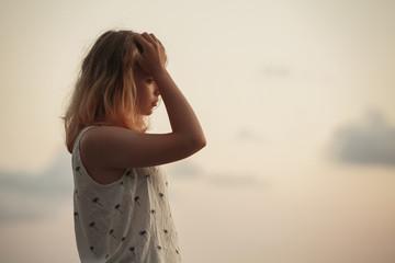 European teenage girl over evening sky