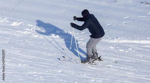 Foto Murales Man skiing in the snow in winter