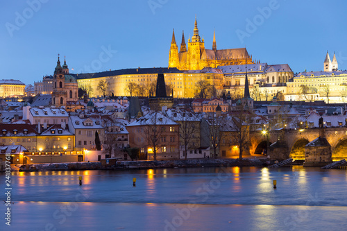obraz PCV Night colorful snowy Christmas Prague Lesser Town with gothic Castle and Charles Bridge, Czech republic