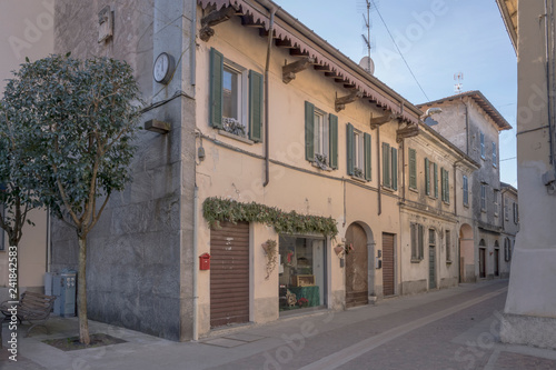 old houses on cobbled street, Angera, Italy - 241842583