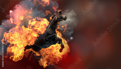 Black running horse on orange fire background