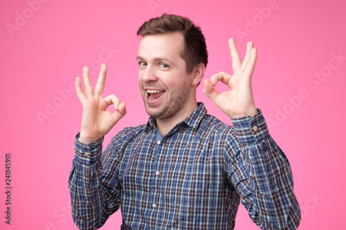 aa5fbe9a Everything is OK concept. Happy young man gesturing OK sign and smiling