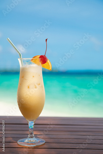 cocunut cocktail and sea background on clear sky day