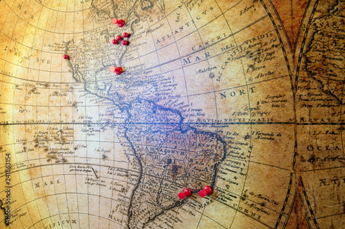 Retro and vintage map.Old illustration of ancient atlas map of world on old paper.Pin marking location on map. Adventure and travel theme background - Image © erkipauk