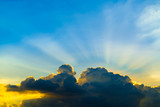 Sun rays through clouds like an dramatic explosion , power nature background. - 241865568