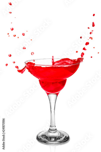 Glass with a red drink.
