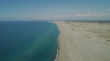 Aerial view lonely beach and Paoay sand dune. Philippines, Luzon. Sand dunes near to the sea with sky. Ilocos Norte. - 241871361