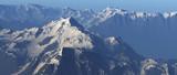 Steep snowy mountains in mist. - 241875113