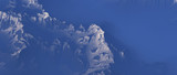 Snow covered mountains in clouds. Aerial view. - 241875114