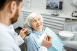 Leinwanddruck Bild - Elderly woman during the medical examination with male dentist in the dental office