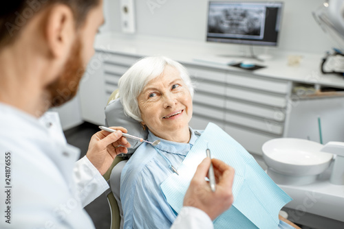 Leinwanddruck Bild Elderly woman during the medical examination with male dentist in the dental office