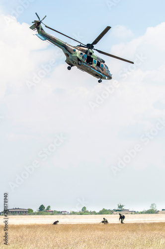 Soldiers on a rescue military operation with helicopter.