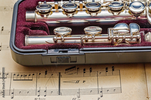 Silver flute on classic sheet muisc - 241891100