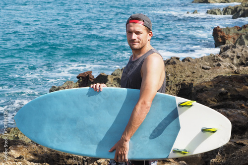 surfer with a board on the ocean. short board