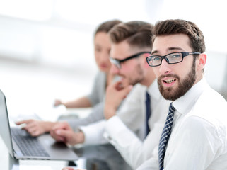 project Manager against the background of the business team