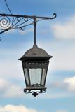Old lantern against  blue sky background - 241908919