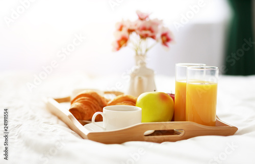 Leinwanddruck Bild breakfast in bed of coffee, croissants, orange juice and fruit on tray