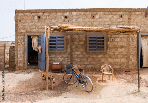 Common house exterior loacated in a popular district in Ouagadougou with electricity power but no running water, Burkina Faso, West Africa.